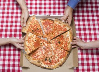 Pizza with hands